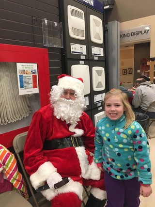 Little girl meeting Santa Dec 15 at Bartle & Gibson